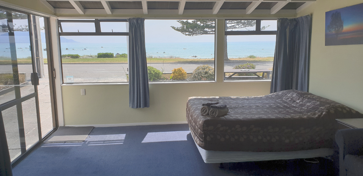 This is a downstairs unit with a magnificent sea view. Bedding in this unit is a queen bed and 3 single beds all in the same studio space as the living and cooking areas.