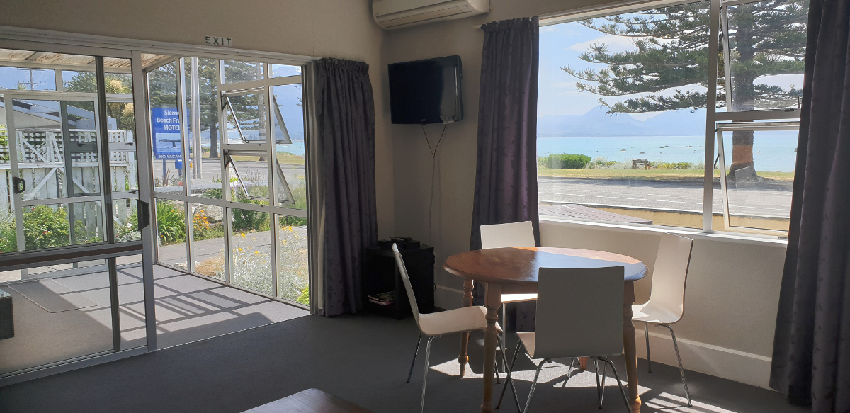 This is a downstairs unit with magnificent sea and mountain views and its own conservatory. Bedding in this unit is a queen bed and a single bed in one bedroom and two single beds in another bedroom.